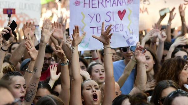 Demonstrators shout slogans Friday in Madrid, a day after a court ordered the release on bail of five men sentenced to nine years in prison for sexually abusing a young woman at Pamplona