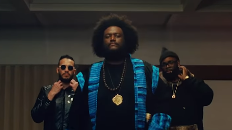 """Kamasi Washington, backed by professional gamer Gootecks, marches to challenge gamer ComboFiend in the video for """"Street Fighter Mas."""""""
