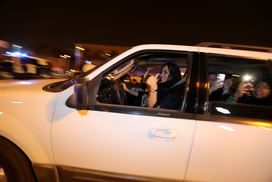 A Saudi woman celebrates with her friends as she drives her car in al-Khobar, Saudi Arabia, on Sunday. The lifting of the ban on women driving marks a milestone for women in the kingdom who have had to rely on drivers, male relatives, taxis and ride-hailing services to get to work, go shopping and simply move around. (Hamad I Mohammed/Reuters)