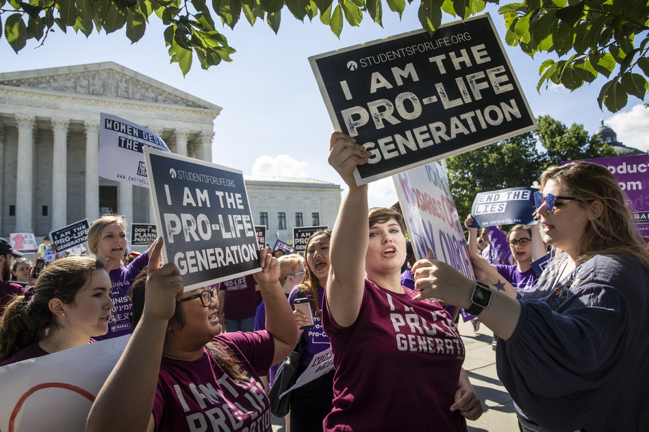 Anti-abortion-rights advocates demonstrate in front of the Supreme Court early Monday. (J. Scott Applewhite/AP)