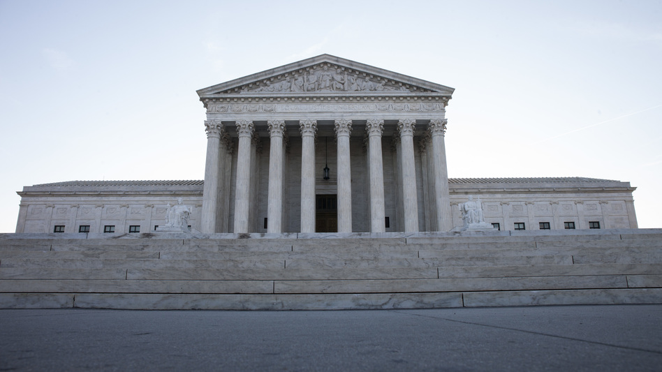 """In a 5-4 decision, the Supreme Court upheld President Trump's travel ban. The court's majority ruled the ban is """"squarely within the scope of Presidential authority under the INA,'"""" referring to the Immigration and Nationality Act. (Zach Gibson/Getty Images)"""