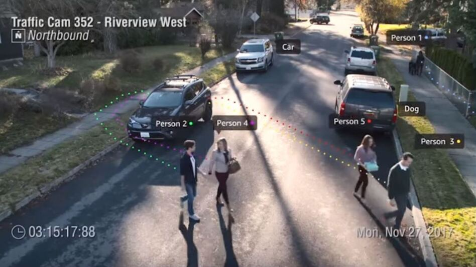 An image from a presentaton by Amazon's Ranju Das shows a demonstration of real-time facial recognition and tracking. Das said the video came from a traffic cam in Orlando, Fla., where police were in a pilot program of Amazon's Rekognition service. (Amazon Web Services Korea via YouTube/Screenshot by NPR)