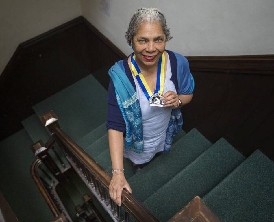 """If my life were to end next week ... I want to feel like I have made a contribution,"" said Carol Martin, seen here holding her 2018 Boston Marathon medal. (Jesse Costa/WBUR)"
