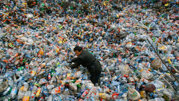A worker sorts plastic bottles at a recycling center in China.