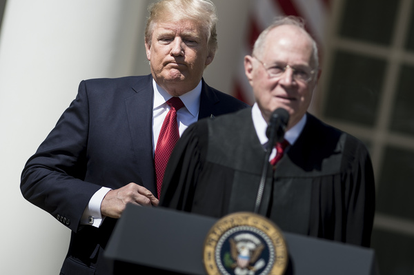 President Trump listens while Supreme Court Justice Anthony Kennedy speaks during a ceremony in the Rose Garden of the White House.