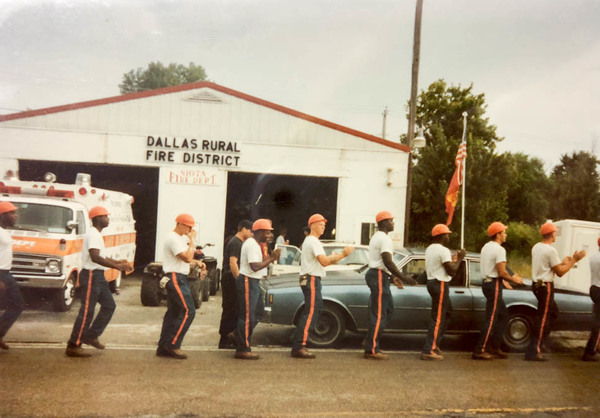 Greg Yance, fourth from the right, with other inmates in a prison boot camp program who tried to shore up the levee in Niota, Ill., with sandbags in July 1993.