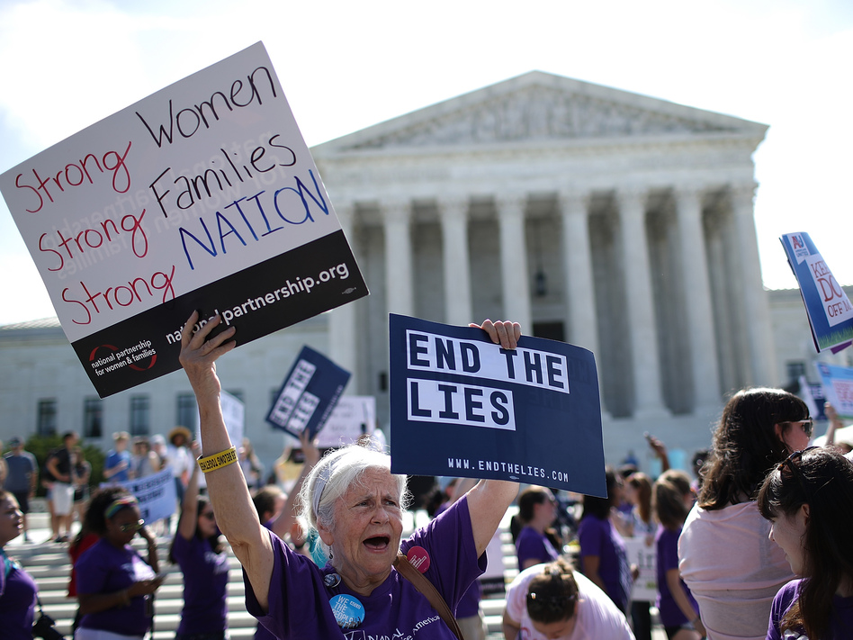 Abortion-rights proponents protest outside the U.S. Supreme Court on Tuesday. The retirement of Justice Anthony Kennedy set the stage for a battle over abortion rights unlike any in a generation. (Win McNamee/Getty Images)