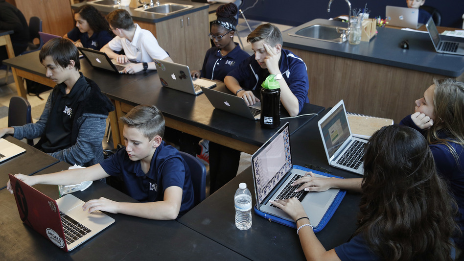 Students work on computers in Henderson, Nev. Several states including Utah and Ohio use automated grading on student essays written as part of standardized tests. (John Locher/AP)