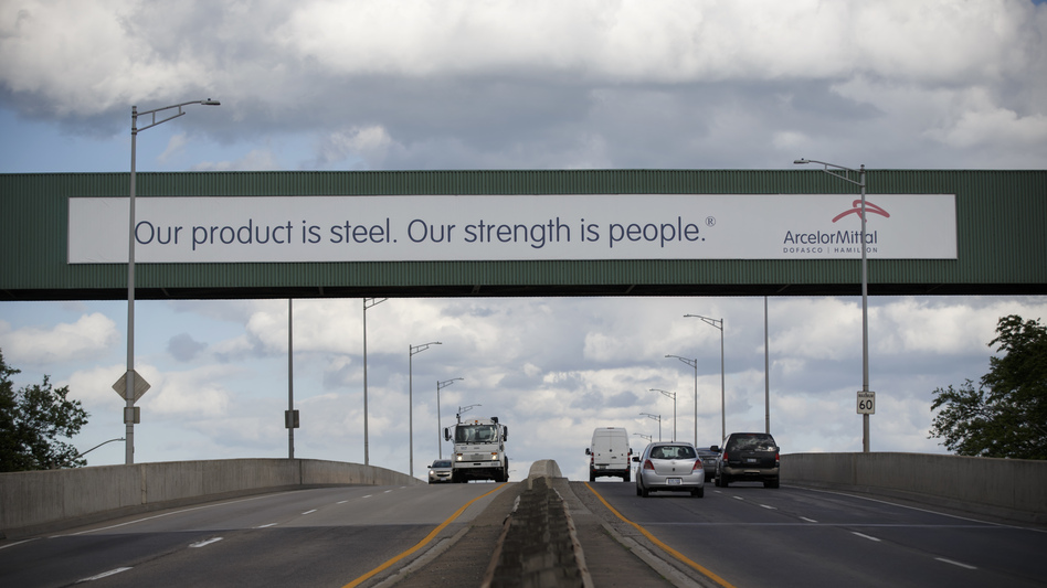 A banner adorns an overpass at ArcelorMittal Dofasco's steel plant in Hamilton, Ontario.