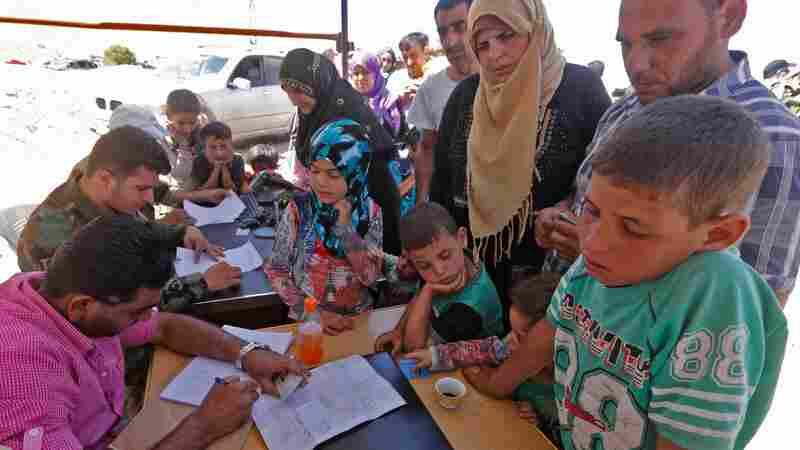 'I Hope To God We Will Be Safe': Refugees In Lebanon Start Returning To Syria