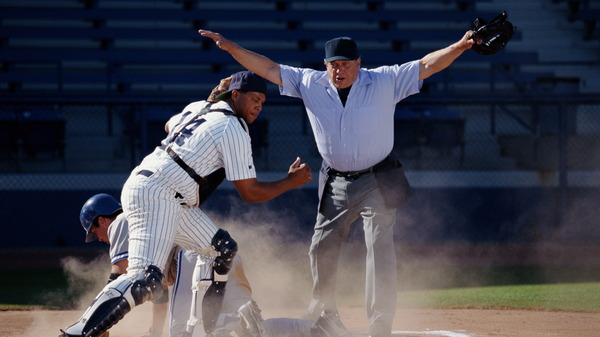 A baseball umpire ruling player