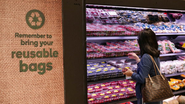 Australian retail chains including Woolworths are removing single-use plastic bags from their stores.