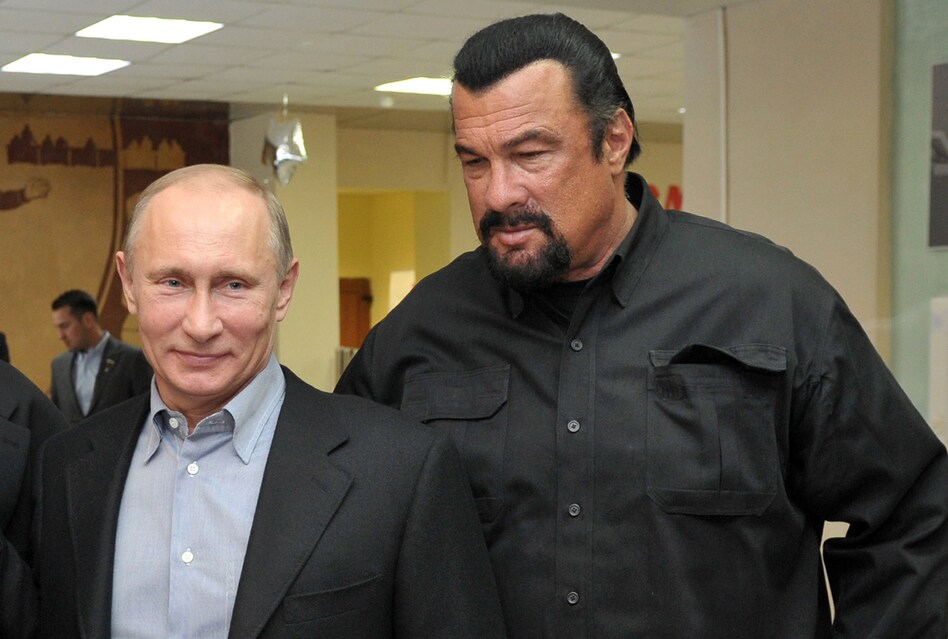 Russia's President Vladimir Putin and American action movie actor Steven Seagal visited a newly built wrestling school in Moscow in 2013. (Alexei Nikolsky/AFP/Getty Images)