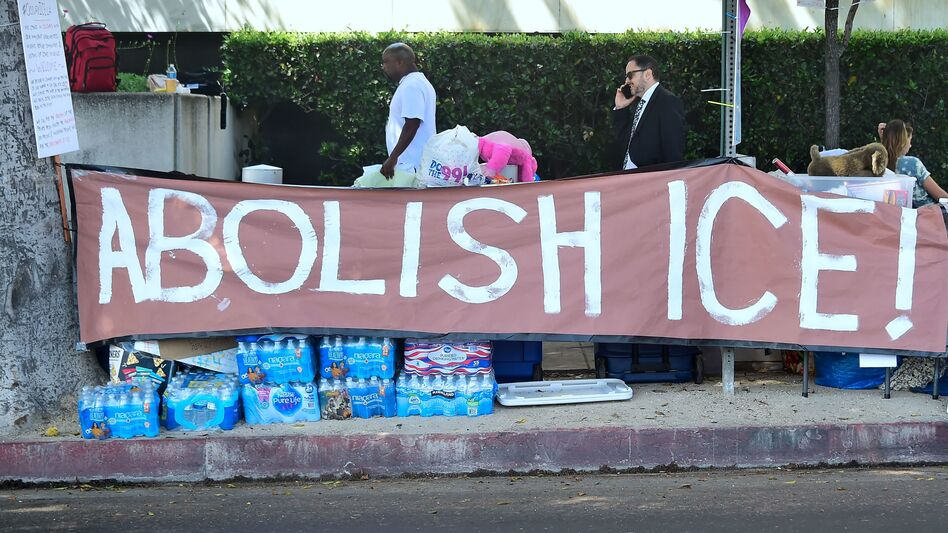 Immigrant rights advocates pitched their tents for an encampment outside the ICE offices in downtown Los Angeles on Thursday. The new liberal rallying cry raises more questions than it answered. (Frederic. J. Brown/AFP/Getty Images)