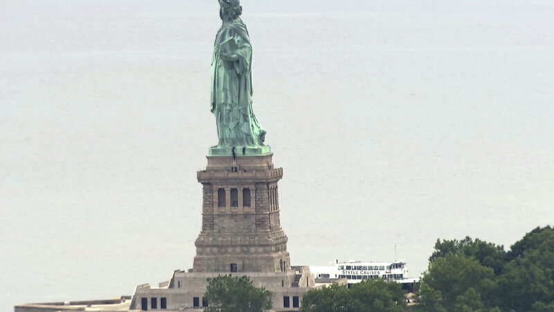 Activists Arrested At Statue Of Liberty After Protesting Trumps