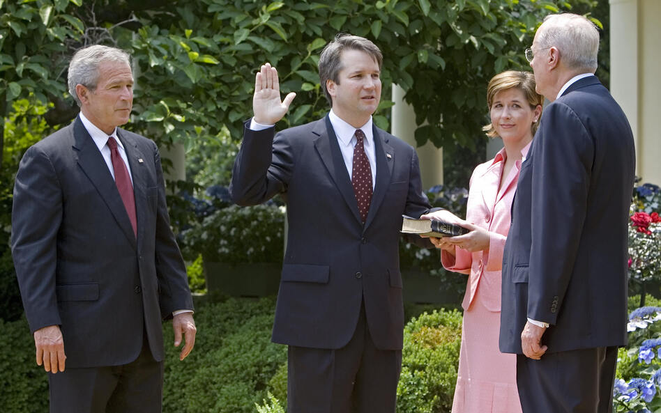 Brett Kavanaugh is sworn in as a federal judge by Supreme Court Justice Anthony Kennedy in 2006. President George W. Bush looks on. Kavanaugh is Trump's pick to replace Kennedy on the Supreme Court. (Paul J. Richards/AFP/Getty Images)