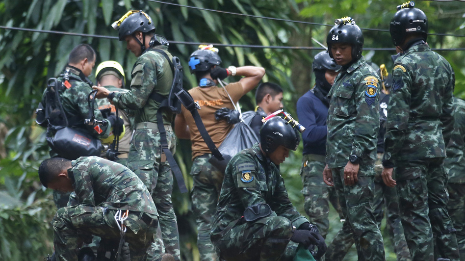 Thai rescue crews prepare Friday to enter the cave where 12 boys and their soccer coach have been trapped in Chiang Rai province, in northern Thailand. A Thai diver died while on a supply mission. (Sakchai Lalit/AP)