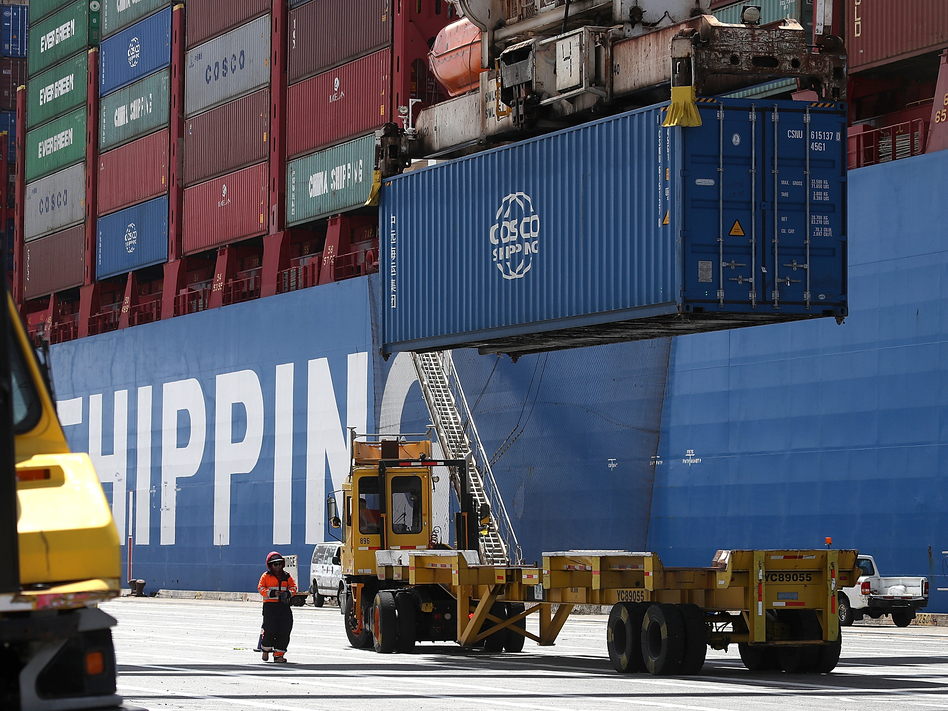 A shipping container is offloaded from the Hong Kong-based ship in Oakland, Calif., last month. (Justin Sullivan/Getty Images)