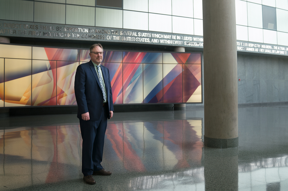 Acting U.S. Census Bureau Director Ron Jarmin stands in the lobby of the agency's headquarters in Suitland, Md. The bureau is facing six lawsuits from more than two dozen states and cities, plus other groups, that want a new question about U.S. citizenship removed from the 2020 census.