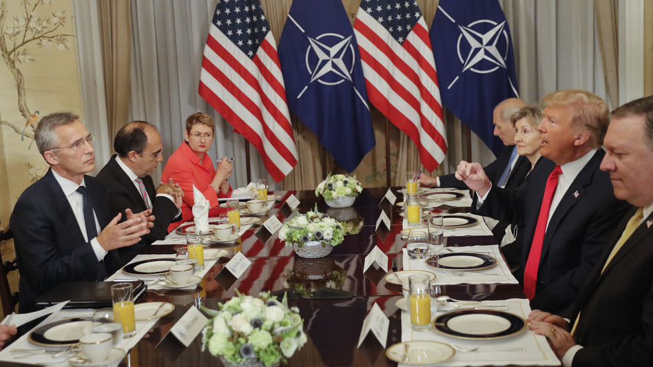 In what was supposed to be a brief photo op ahead of a breakfast meeting, President Trump launched a verbal attack against NATO defense spending as cameras clicked away.