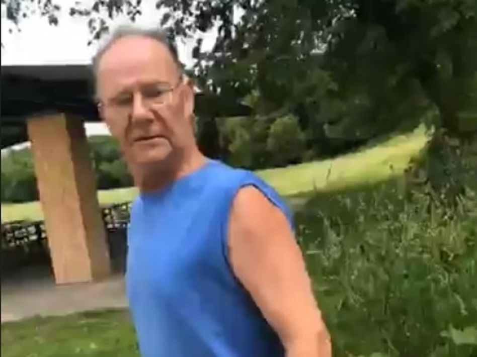 A man identified as Timothy Trybus harasses a woman for wearing a shirt with the Puerto Rican flag.