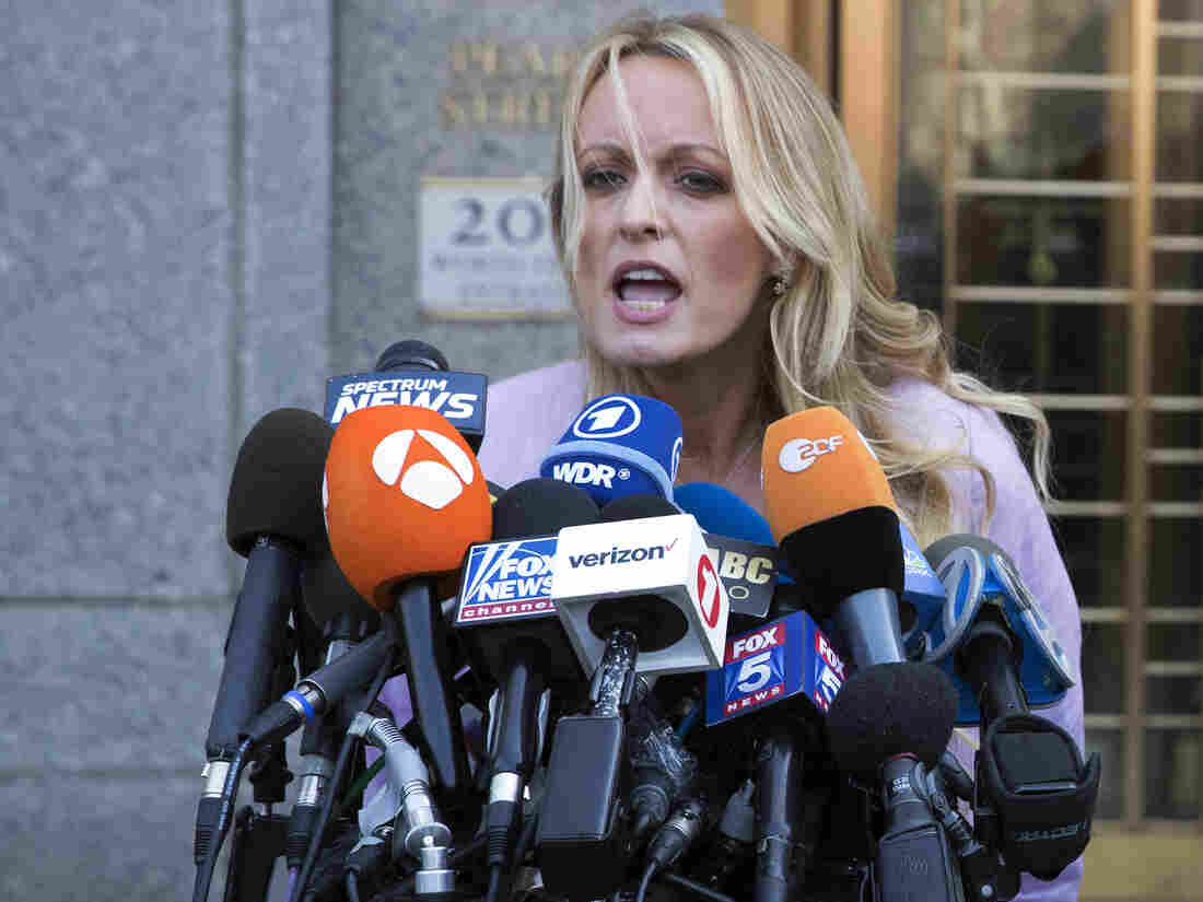 Stormy Daniels poses for her mugshot after strip club arrest