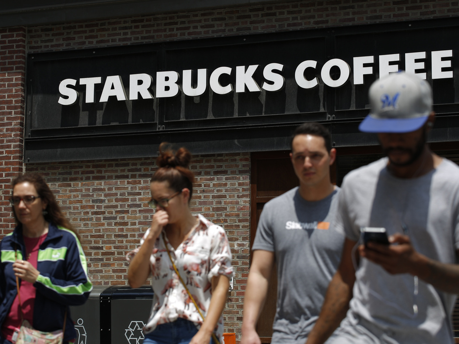 Pedestrians walk outside the closed Spruce St. Starbucks store on May 29, 2018 in Philadelphia, Pennsylvania.