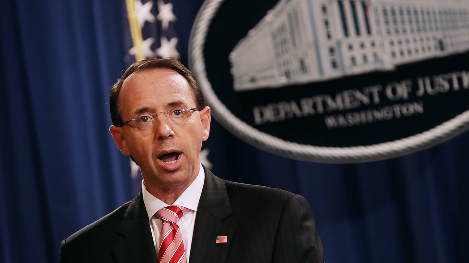 U.S. Deputy Attorney General Rod Rosenstein holds a news conference at the Department of Justice on Friday in Washington, D.C. Rosenstein announced indictments against 12 Russian intelligence agents for hacking computers during the 2016 presidential election.