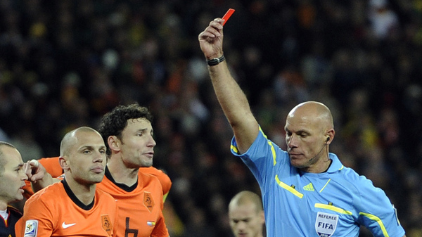 Referee Howard Webb of England, right, shows the red card to Netherlands