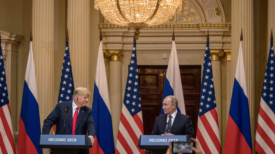 President Trump and Russian President Vladimir Putin speak to the media during a joint press conference after their summit on Monday in Helsinki. (Chris McGrath/Getty Images)