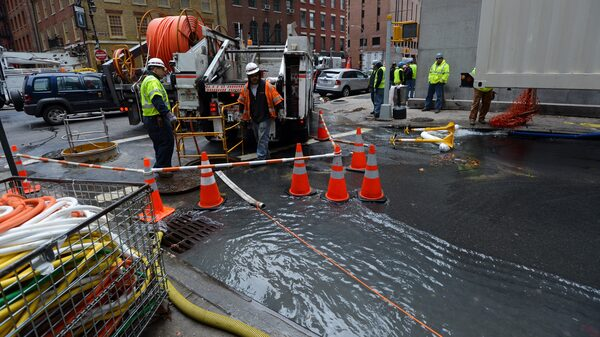 Verizon crews pump water from an access tunnel in Manhattan in 2012 after flooding from Superstorm Sandy knocked out underground Internet cables.