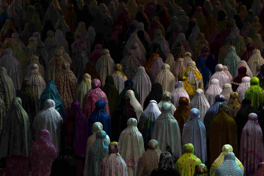 Muslim women praying together in Istiqlal mosque, Jakarta, Indonesia.