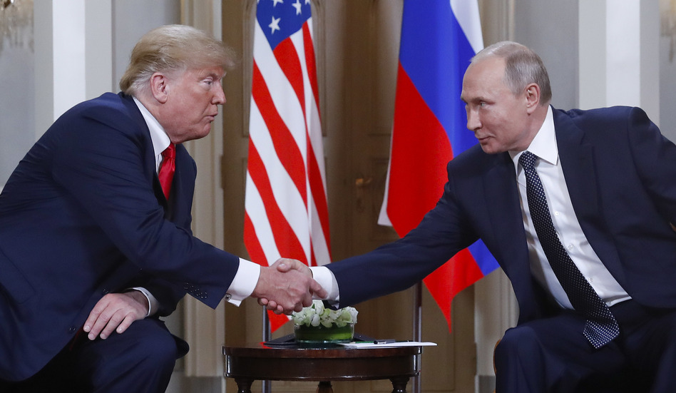 President Trump and Russian President Vladimir Putin shake hands at their summit in Helsinki, Finland, on Monday. Trump upset many in the U.S. intelligence community by refusing to endorse their finding that Russia interfered in the 2016 presidential election. Putin said he favored Trump in the election, but did not indicate whether he did anything to help him. (Pablo Martinez Monsivais/AP)