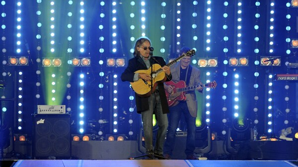 Scottish singer Dougie MacLean performs during the 2014 Commonwealth Games at Hampden Park in Glasgow, Scotland, in August 2014.