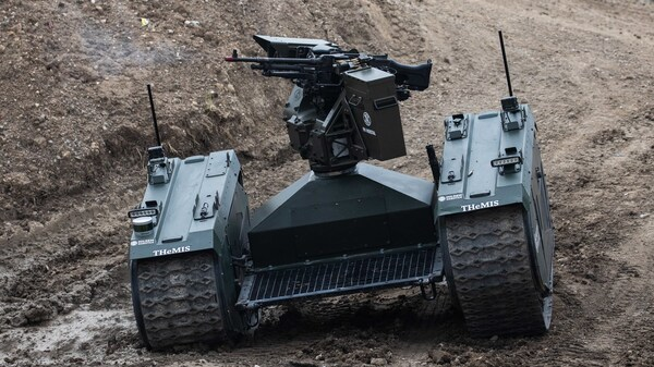 An autonomous tank is demonstrated in France last month. Leading researchers in artificial intelligence are calling for laws against lethal autonomous weapons. They also pledge not to work on such weapons.