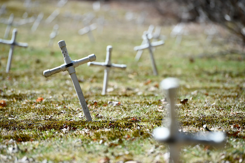 """Nearly 90 former inmates are buried here on the grounds of the North Central Correctional Institution at Gardner. Before inmates, the state buried patients housed at what once was the Gardner State Colony for the """"mentally disturbed."""" (Meredith Nierman/WGBH)"""