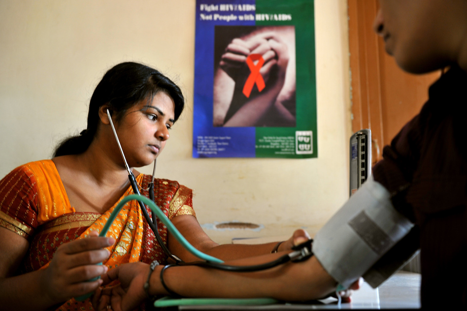A nurse tests an HIV-positive patient at a clinic in Bangalore, India. (Manjunath Kiran /AFP/Getty Images)