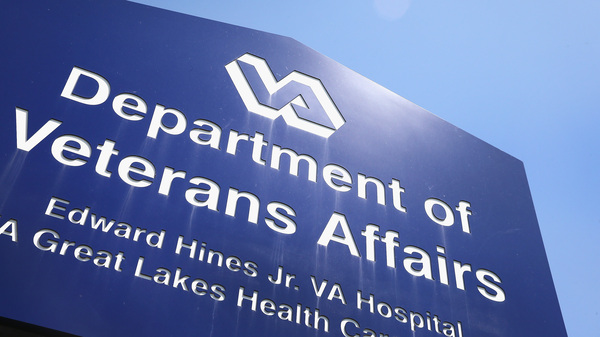 A sign marks the entrance to a VA Hospital in Hines, Ill.
