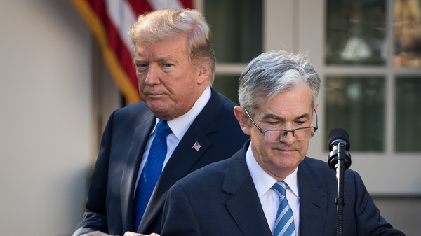 """President Trump looks on as his nominee for Federal Reserve chairman, Jerome Powell, speaks at the White House on Nov. 2. On Thursday, Trump said he is """"not thrilled"""" about Fed interest rate hikes."""