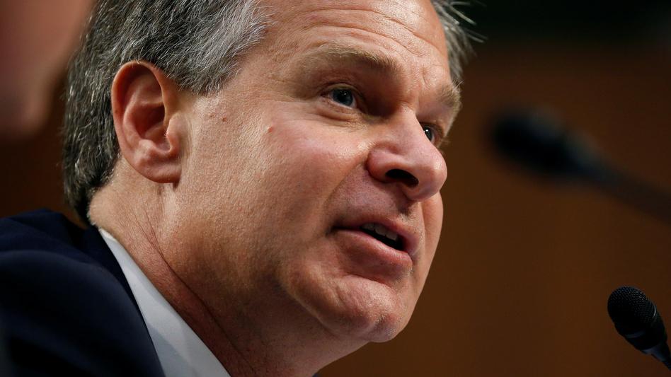 FBI Director Christopher Wray testifies on Capitol Hill on June 18. (Joshua Roberts/Reuters)