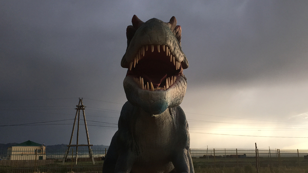 A fake dinosaur is a tourist attraction on the Silk Road in Mongolia.