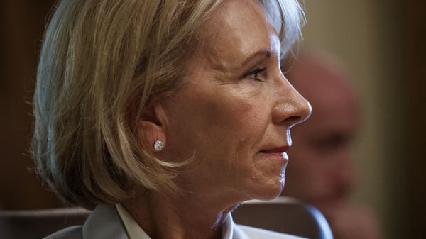 Secretary of Education Betsy DeVos listens as President Donald Trump speaks during a cabinet meeting at the White House on June 21, 2018. DeVos issued new guidance last fall on how campuses should handle cases of sexual assault.