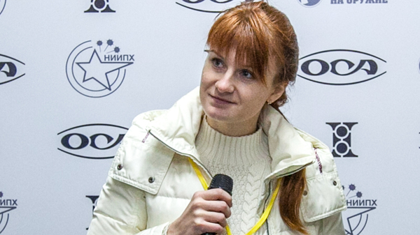 Maria Butina, leader of a pro-gun organization, speaks on Oct. 8, 2013, during a news conference in Moscow.