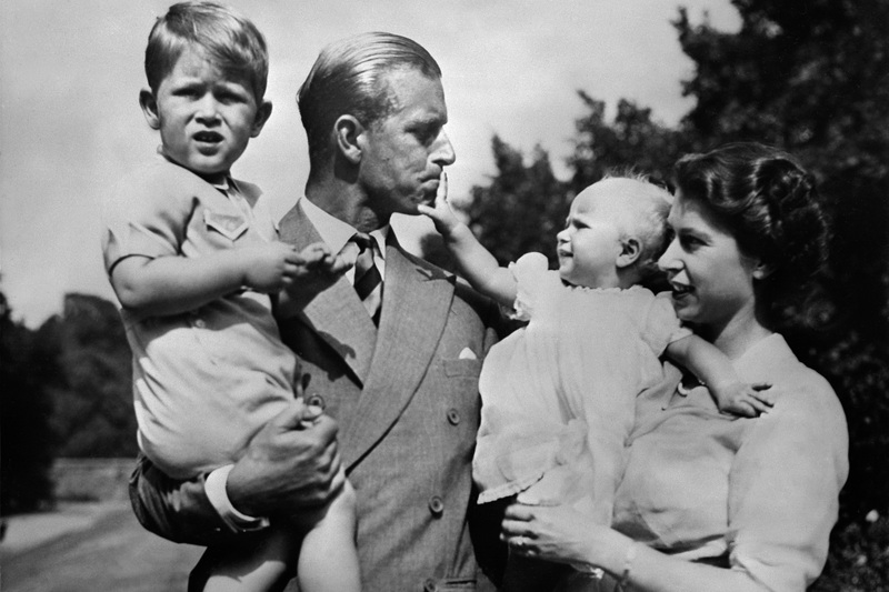 Philip and Elizabeth carry around their eldest children, Prince Charles and Princess Anne, circa 1951.