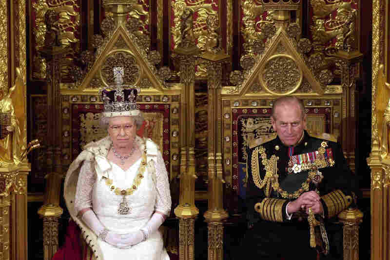 Queen Elizabeth II and Prince Philip attend the state opening of Parliament in London in 2000.