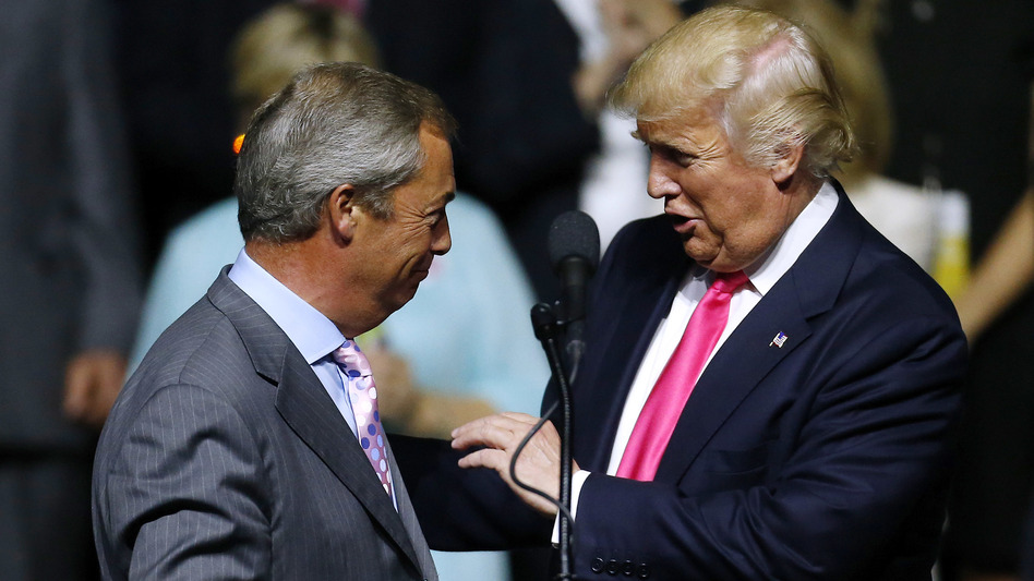 """Republican presidential nominee Donald Trump greets British politician Nigel Farage during a campaign rally in Jackson, Miss., on Aug. 24, 2016. Journalist Carole Cadwalladr says """"there are so many overlaps"""" between Russia, the Trump campaign and the Brexit vote. (Jonathan Bachman/Getty Images)"""
