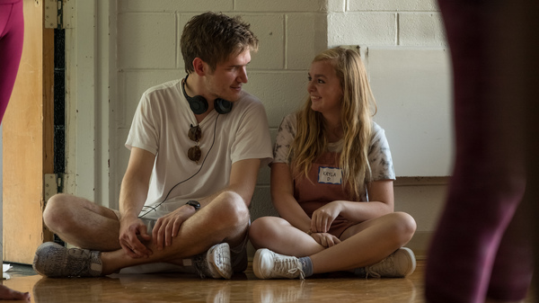 Writer and director Bo Burnham talks with Elsie Fisher on the set of Eighth Grade. Burnham says the anxiety he felt as a young performer helped him understand the social pressure teenage girls can experience.