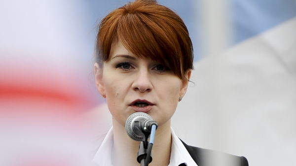 Maria Butina, photographed in 2013 at a pro-gun rally in Moscow, is charged with conspiring to act as a Russian agent.