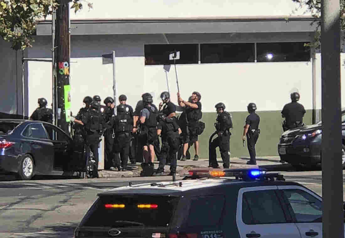 Los Angeles shootout: One dead, suspect held after taking hostages at supermarket