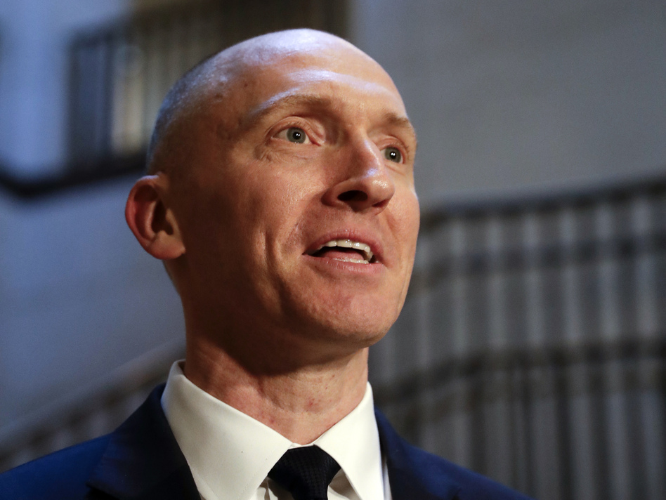 Carter Page speaks with reporters in November 2017 following a day of questions from the House intelligence committee on Capitol Hill in Washington. (J. Scott Applewhite/AP)